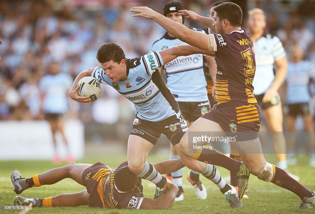 Chad Townsend of the Sharks takes on the defence during the round nine NRL match between the Cronulla Sharks and the Brisbane Broncos at Southern Cross Group Stadium on May 1, 2016 in Sydney, Australia.