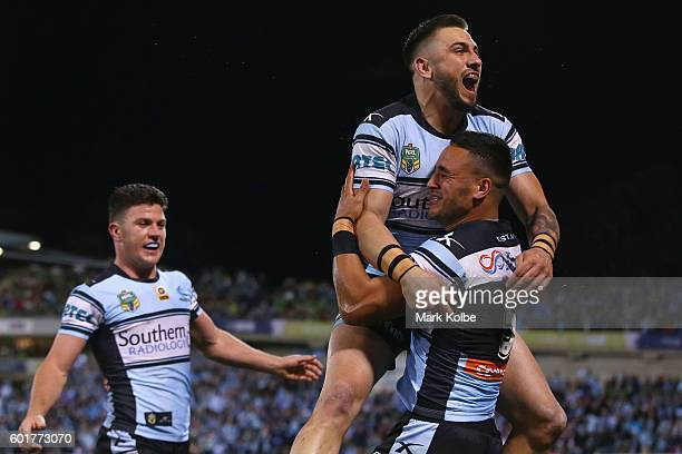 Chad Townsend of the Sharks watches on as Jack Bird and Valentine Holmes of the Sharks celebrate Holmes scoring a try during the NRL Qualifying Final...