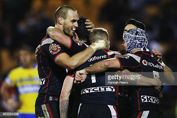 Chad Townsend of the Warriors celebrates with the team after scoring a try during the round 18 NRL match between the New Zealand Warriors and the...