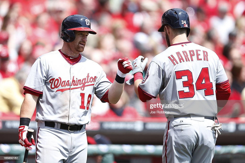 Chad Tracy #18 and Bryce Harper #34 of the Washington Nationals celebrate after Harper's two-run home run in the third inning of the game against the Cincinnati Reds at Great American Ball Park on April 6, 2013 in Cincinnati, Ohio.