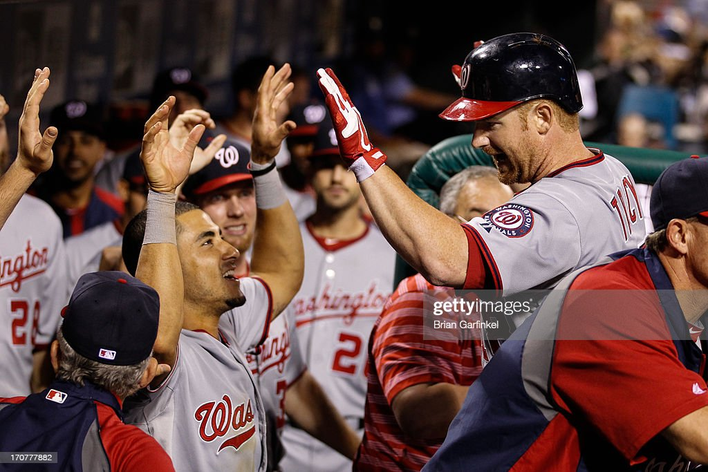 <a gi-track='captionPersonalityLinkClicked' href=/galleries/search?phrase=Chad+Tracy&family=editorial&specificpeople=213807 ng-click='$event.stopPropagation()'>Chad Tracy</a> #18 of the Washington Nationals is congratulated by teammates in the dugout after hitting a home run to tie the game in the top of the ninth inning of the game against the Philadelphia Phillies at Citizens Bank Park on June 17, 2013 in Philadelphia, Pennsylvania. The Phillies won 5-4.