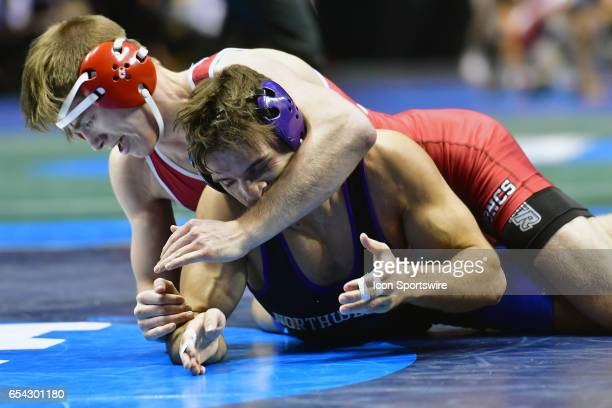 Chad Walsh of Rider maintains control of Johnny Sebastian of Northwestern in a 165pound match during the first round of the NCAA Wrestling...