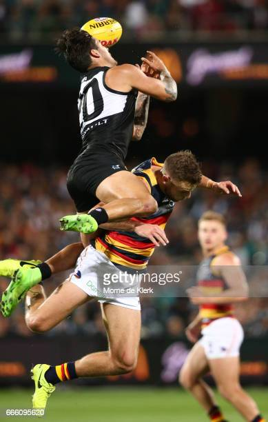 Chad Wingard of the Power attempts a mark over Brodie Smith of the Crows during the round three AFL match between the Port Adelaide Power and the...