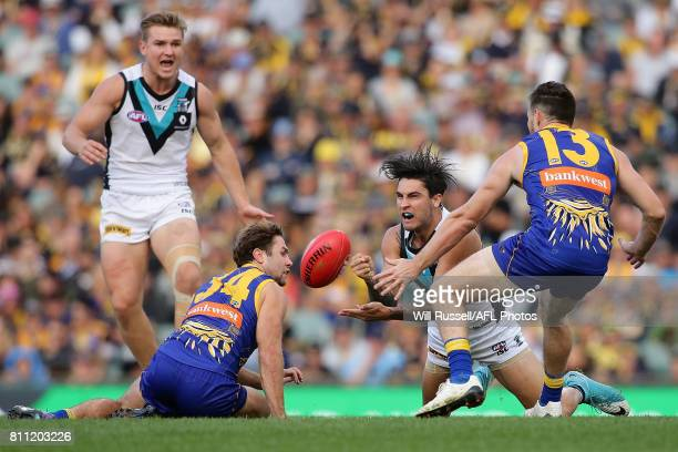 Chad Wingard of the Power handpasses the ball during the round 16 AFL match between the West Coast Eagles and the Port Adelaide Power at Domain...