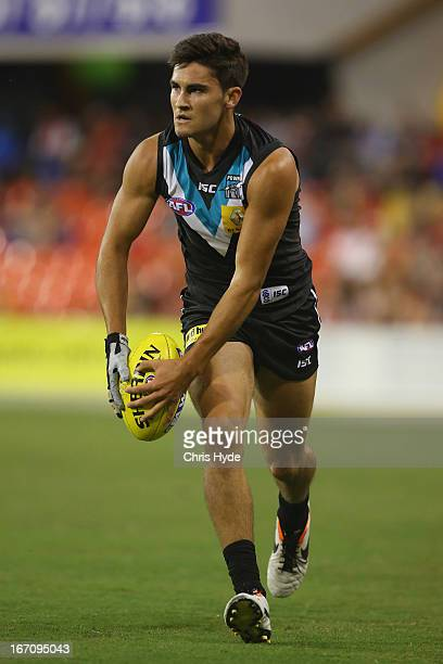 Chad Wingard of the Power kicks a goal during the round four AFL match between the Gold Coast Suns and Port Adelaide Power at Metricon Stadium on...
