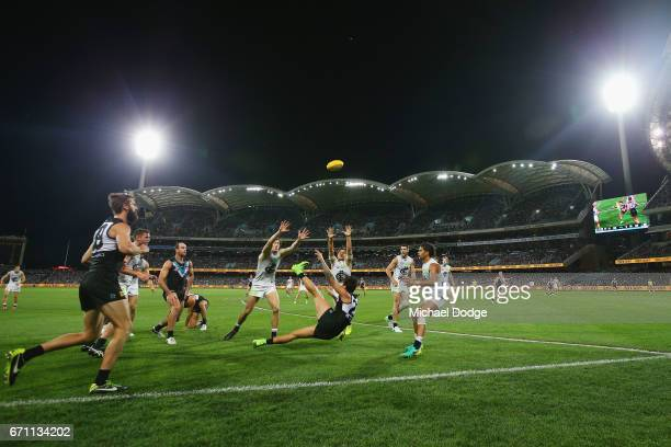 Chad Wingard of the Power kicks the ball over his head during the round five AFL match between the Port Adelaide Power and thew Carlton Blues at...