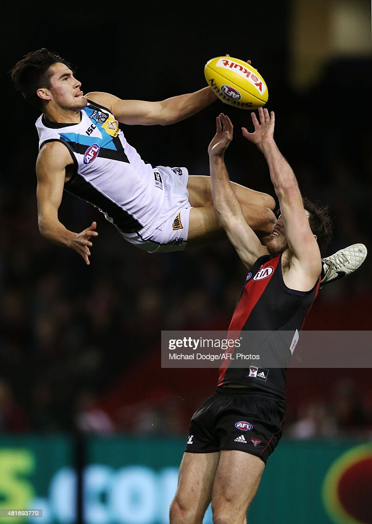 Chad Wingard of the Power leaps for a high mark attempt over Michael Hibberd of the Bombers during the round 17 AFL match between the Essendon Bombers and the Port Adelaide Power at Etihad Stadium on July 25, 2015 in Melbourne, Australia.