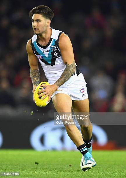 Chad Wingard of the Power looks to pass the ball during the round 12 AFL match between the Essendon Bombers and the Port Adelaide Power at Etihad...