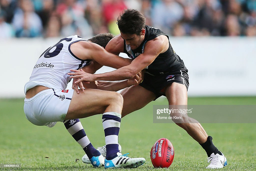 Chad Wingard of the Power tackles Alex Silvagni of the Dockers during the round eight AFL match between the Port Adelaide Power and Fremantle Dockers at Adelaide Oval on May 10, 2014 in Adelaide, Australia.