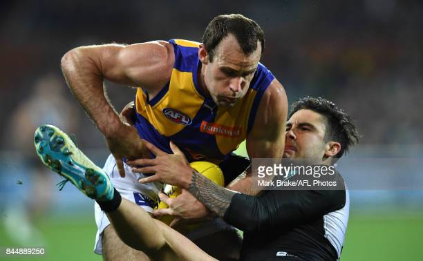 Chad Wingard of the Power tackles Shannon Hurn of the Eagles during the AFL First Elimination Final match between Port Adelaide Power and West Coast...