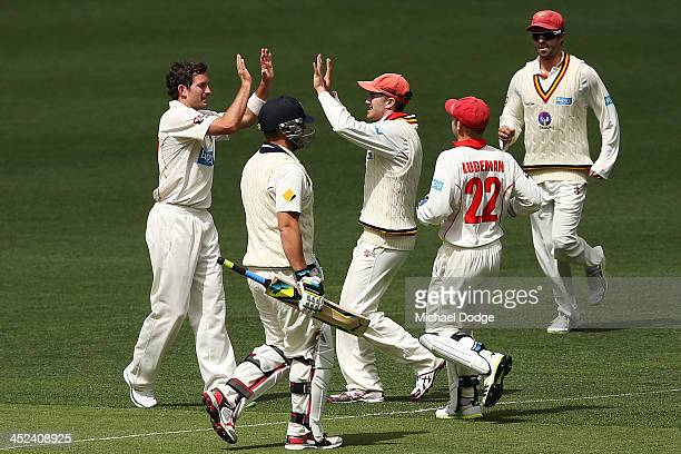 Chadd Sayers and Michael Klinger of the Redbacks celebrates the wicket of Aaron Finch of the Bushrangers during day one of the Sheffield Shield match...