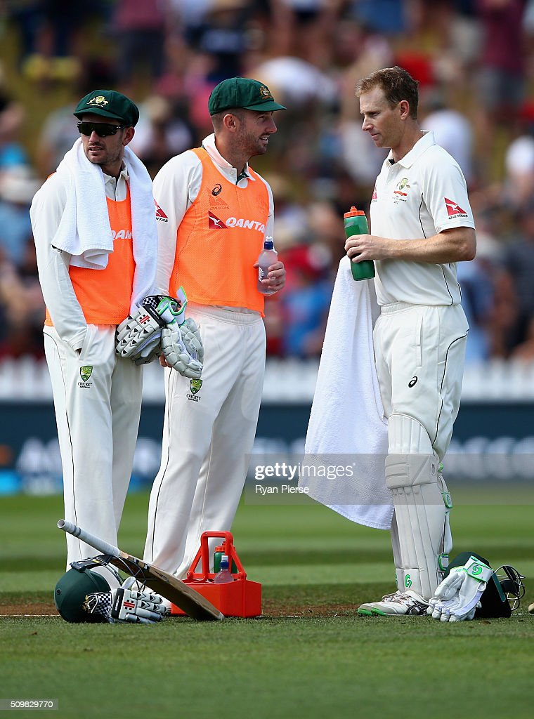 Chadd Sayers and <a gi-track='captionPersonalityLinkClicked' href=/galleries/search?phrase=Shaun+Marsh+-+Cricket+Player&family=editorial&specificpeople=236104 ng-click='$event.stopPropagation()'>Shaun Marsh</a> of Australia run drinks out to <a gi-track='captionPersonalityLinkClicked' href=/galleries/search?phrase=Adam+Voges&family=editorial&specificpeople=724770 ng-click='$event.stopPropagation()'>Adam Voges</a> of Australia during day two of the Test match between New Zealand and Australia at Basin Reserve on February 13, 2016 in Wellington, New Zealand.