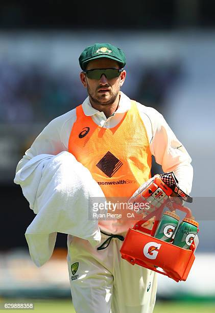 Chadd Sayers of Australia runs the drinks during day one of the First Test match between Australia and Pakistan at The Gabba on December 15 2016 in...