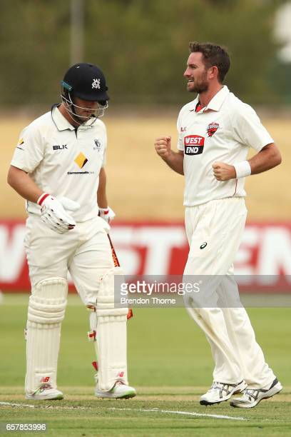 Chadd Sayers of the Redbacks celebrates after claiming the wicket of Aaron Finch of the Bushrangers during the Sheffield Shield final between...