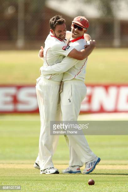 Chadd Sayers of the Redbacks celebrates with team mate Jake Lehmann of the Redbacks after claiming the wicket of Cameron White of the Bushrangers...