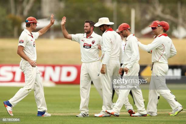 Chadd Sayers of the Redbacks celebrates with team mates after claiming the wicket of Aaron Finch of the Bushrangers during the Sheffield Shield final...
