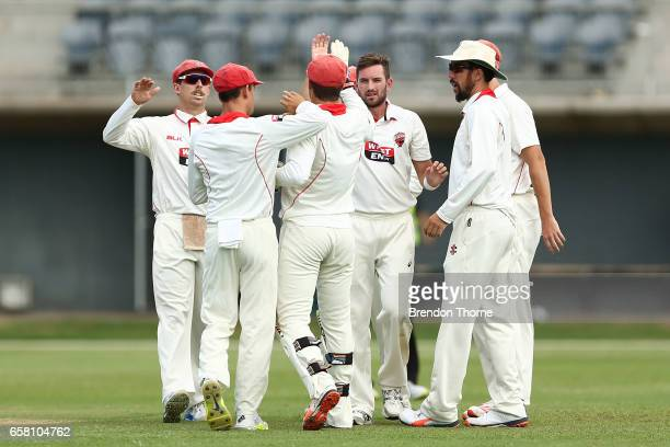 Chadd Sayers of the Redbacks celebrates with team mates after claiming the wicket of Rob Quiney of the Bushrangers during the Sheffield Shield final...