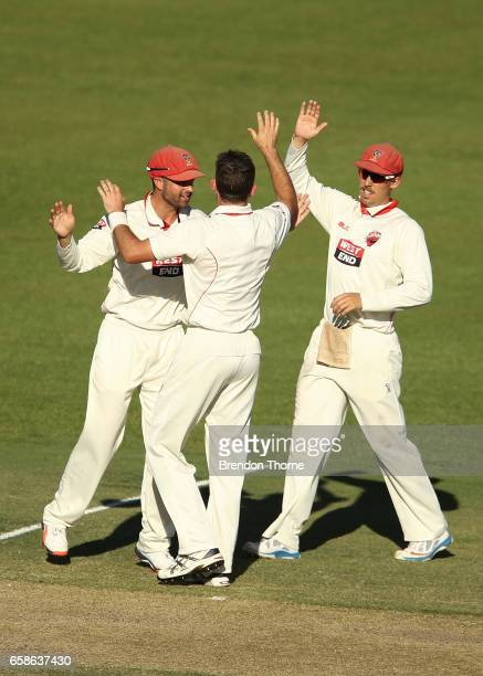 Chadd Sayers of the Redbacks celebrates with team mates after claiming the wicket of Marcus Harris of the Bushrangers during the Sheffield Shield...