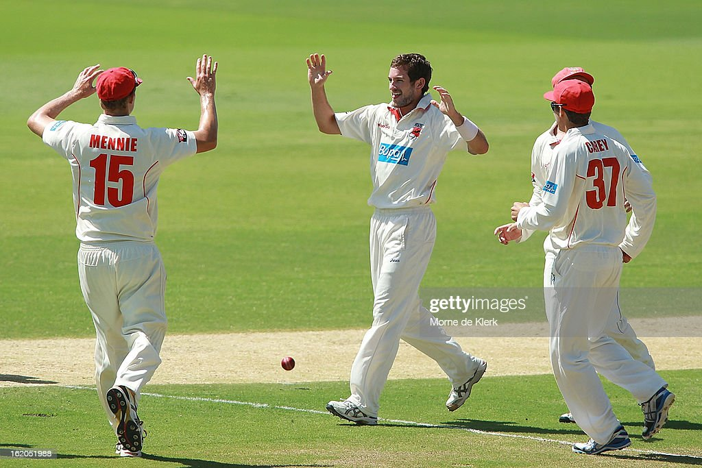 Chadd Sayers (C) of the Redbacks is congratulated by team mates after getting a wicket during day one of the Sheffield Shield match between the South Australian Redbacks and the New South Wales Blues at Adelaide Oval on February 19, 2013 in Adelaide, Australia.