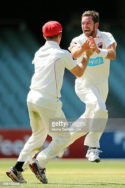 Chadd Sayers of the Redbacks is congratulated by teammates as he celebrates getting a hattrick during day one of the Sheffield Shield match between...