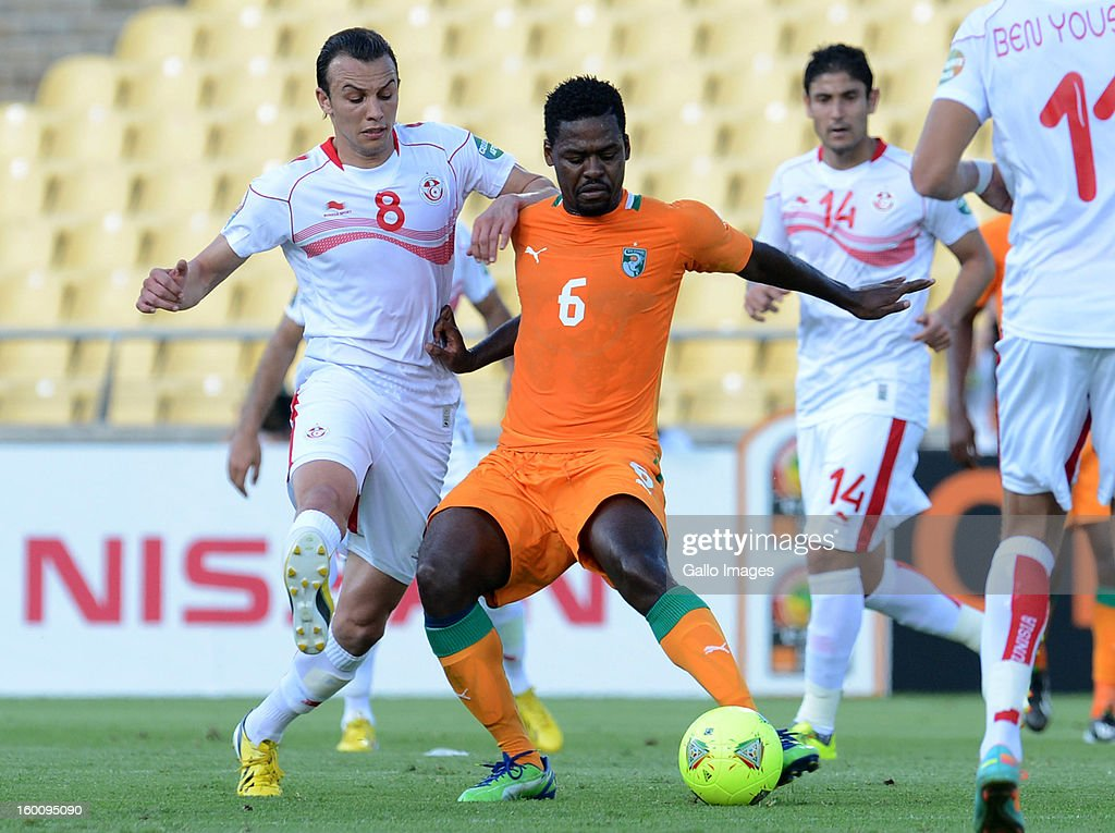 Chadi Hammami of Tunisia and Romaric N'Dri of Ivory Coast (R) during the 2013 African Cup of Nations match between Ivory Coast and Tunisia at Royal Bafokeng Stadium on January 26, 2013 in Rustenburg, South Africa.