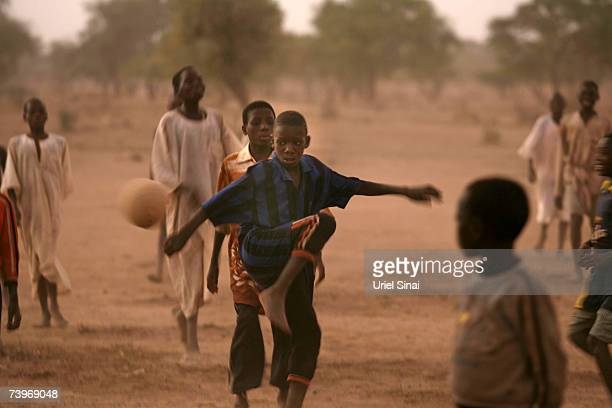 Chadian boys play football as the sun comes down over Habile IDP Camp near the border with Sudan April 20 2007 in Chad tensions between Chad and...