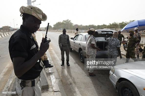 Chadian customs officers control a car on April 4 2015 on the N'Gueli bridge marking the border between Chad and Cameroon near N'Djamena N'Gueli...