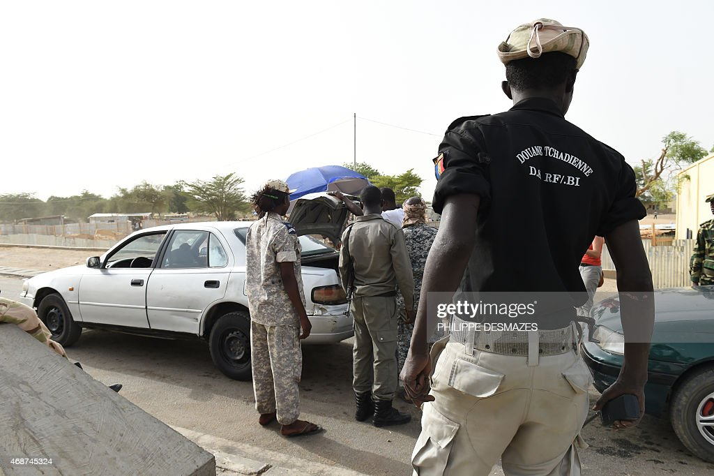 Chadian customs officers control cars on April 4 2015 on the N'Gueli bridge marking the border between Chad and Cameroon near N'Djamena N'Gueli...