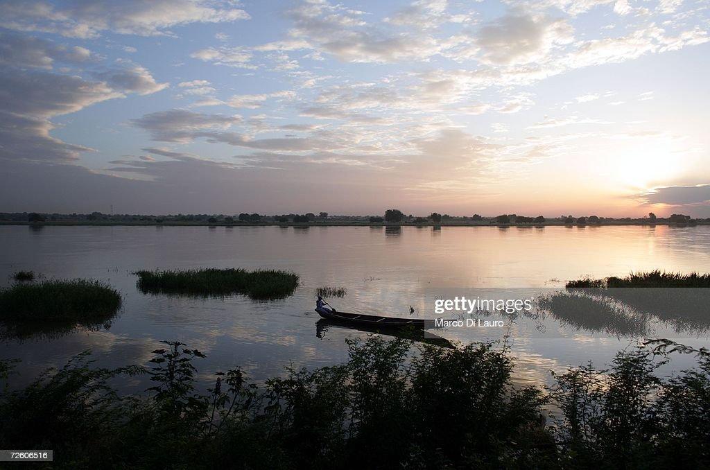 N'DJAMENA CHAD NOVEMBER 3 Chadian fisherman paddles his boat on the Chari River on November 3 2006 in N'Djamena Chad Chad declared a state of...