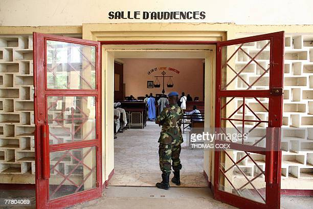 A Chadian gendarme stands guard at the entrance to a second court room during a trial at the same time French charity Zoe's Ark members attend a...