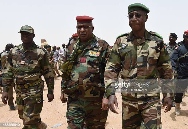 Chadian General Brahim Seid is welcommed by Nigerien General Seyni Garba at the airport of Diffa southeastern Niger on April 3 near the Nigerian town...