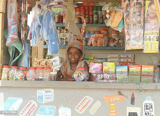 N'DJAMENA CHAD JUNE 22 A Chadian kid stands in a grocery store at a slumdog of N'djamena Chad on June 22 2015 Referred to as the 'Dead Heart of...