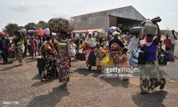 Chadian nationals and other foreign civilians mostly Muslims wait with their belongings to be evacuated to N'Djamena as they flee Bangui to avoid...