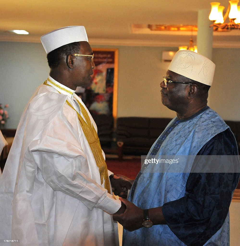 Chadian President Idriss Deby Itno (L) welcomes Mali's president-elect Ibrahim Boubacar Keita on August 26, 2013 in the eastern desert town of Iriba, where the Chadian head of state is spending his holidays. Keita flew to Chad to thank the central African country for its backing in Bamako's fight against armed groups linked to Al-Qaeda. The 2,000 Chadian soldiers of the African-led International Support Mission in Mali were at the forefront of a French-led military intervention launched in January to oust Islamist rebels who had taken over northern Mali in the chaos following a coup.