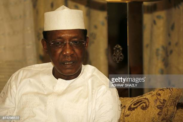 Chadian President Idriss Deby meets with his Sudanese counterpart upon his arrival at Khartoum's airport for an official oneday visit on March 8 2016...