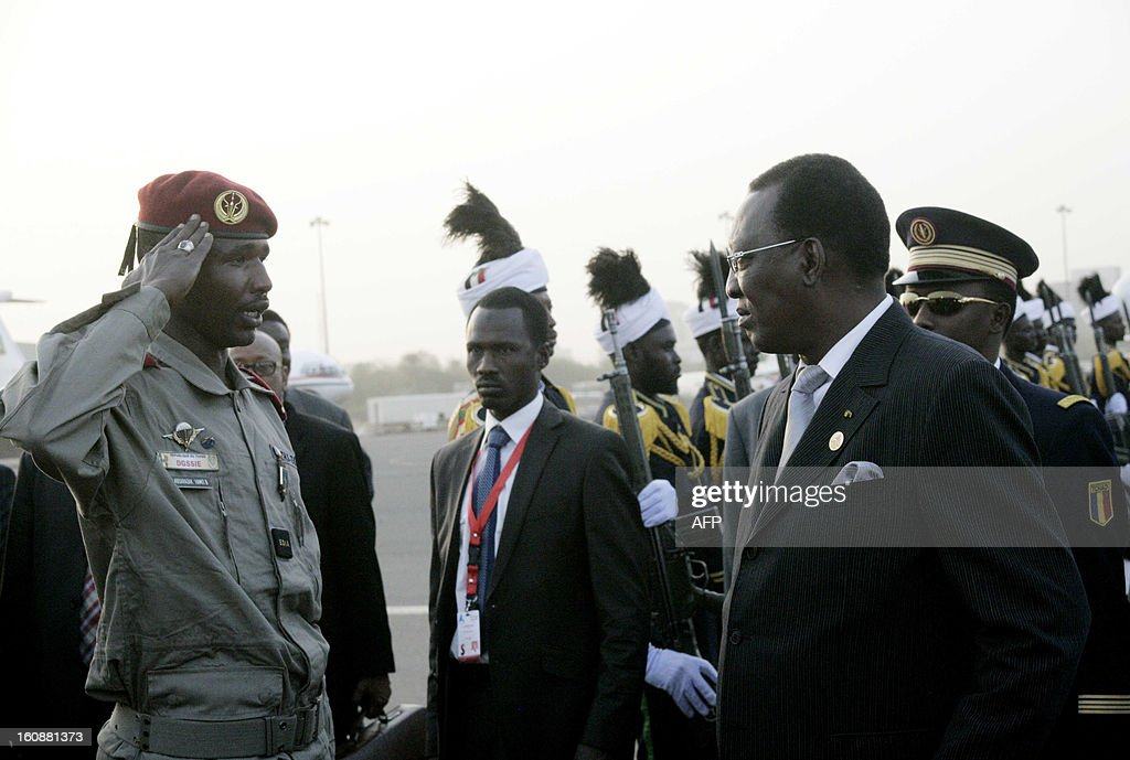Chadian President Idriss Deby (R) reviews troops upon his arrival at the Khartoum airport for an official visit to Sudan on February 7, 2013.