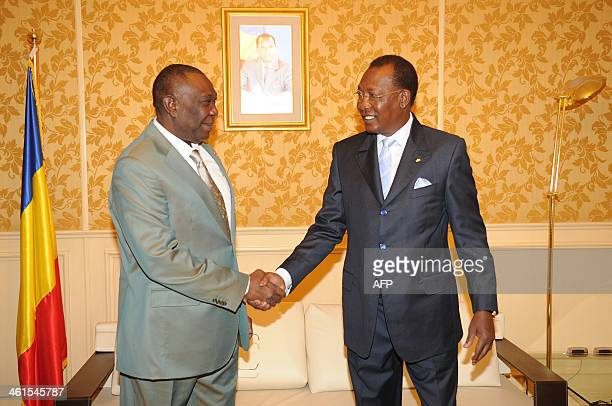 Chadian President Idriss Deby shakes hands with his counterpart from Central Africa Michel Djotodia during the special summit of the 10nation...