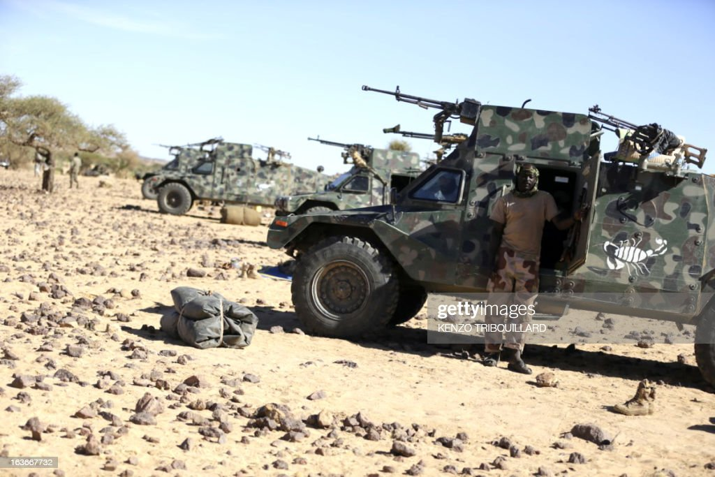 Chadian Presidential guard regiment armored light vehicles are pictured on March 14, 2013 before patrolling in the desert near Tessalit, Mali. French and Chadian troops engaged in AFISMA, the African mission of more than 6,000 soldiers, continue to battle Islamists entrenched in the northeastern Ifoghas mountains and in the desert around Gao. AFP PHOTO / KENZO TRIBOUILLARD