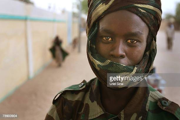 A Chadian soldier stands on the streets of Abeche Chad on April 2007 Tensions between Chad and Sudan have risen over recent weeks following border...