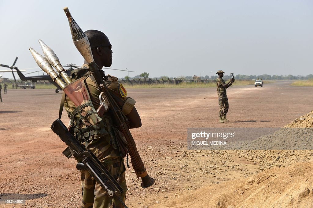 A Chadian soldier with rocket-propelled grenade launcher stands guard at their base near the International Airport in Bangui on December 21, 2013. More than 30 people including a Chadian peacekeeper have been killed in a fresh outbreak of brutal sectarian violence in the Central African Republic capital, sources said yesterday.