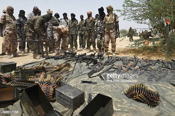 Chadian soldiers display arms captured from Boko Haram militants on April 3 2015 in Malam Fatori in northeastern Nigeria which was retaken from...