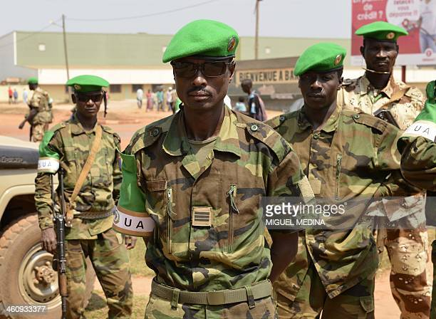 Chadian soldiers from the Misca pose at the entry to Bangui airport in Bangui on January 6 2014 French and African Union troops have been struggling...
