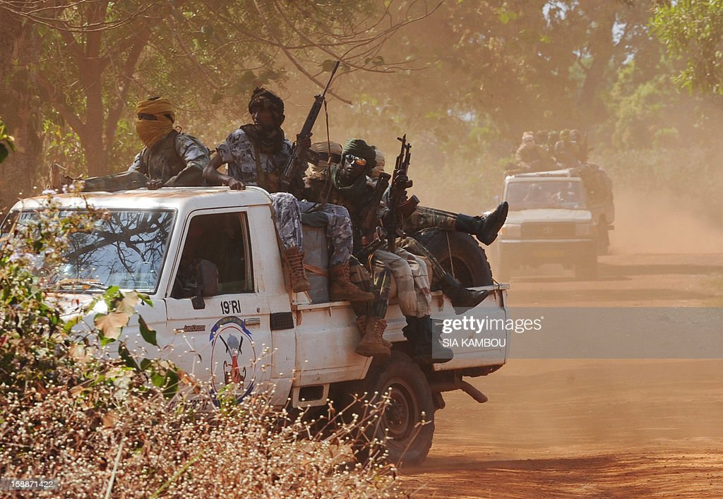 Chadian soldiers, part of a convoy of the FOMAC multinational force of central African states, man a position near Damara on January 2, 2013. The commander of the multinational African force FOMAC warned rebels in the Central African Republic against trying to take the key town of Damara, saying it would 'amount to a declaration of war'. Damara is the last strategic town between the Seleka rebel coalition and the capital Bangui, after the rebels seized much of the country in a three-week advance that began in the north and has brought them to within 160 kilometres (100 miles) of the capital, in the south.