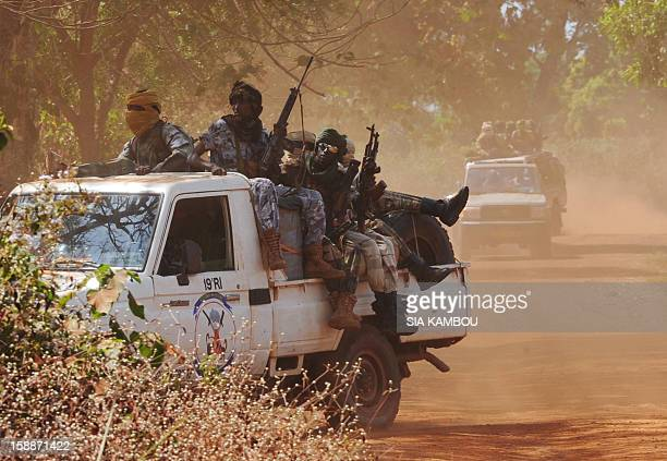 Chadian soldiers part of a convoy of the FOMAC multinational force of central African states man a position near Damara on January 2 2013 The...