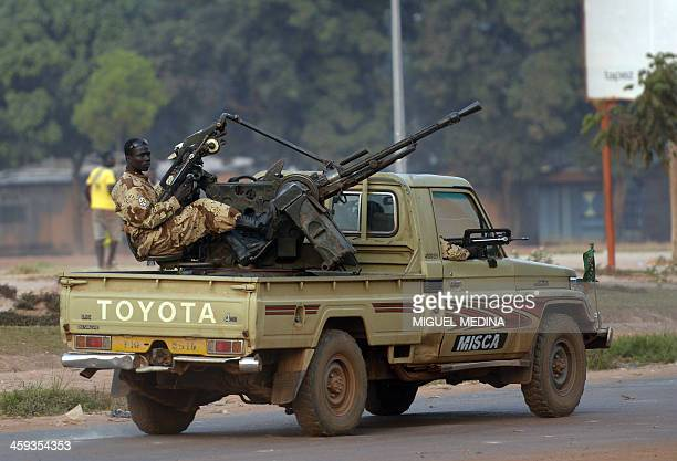 Chadian soldiers part of the MISCA drive by in the 'Combattant' district close to the airport in Bangui on December 25 2013 Heavy arms fire triggered...