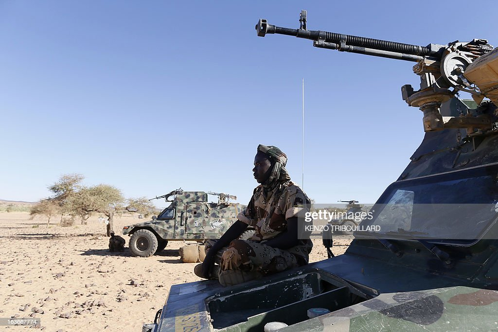 Chadian soldiers prepare their vehicles on March 14, 2013 before patrolling in the desert near Tessalit, Mali. French and Chadian troops engaged in AFISMA, the African mission of more than 6,000 soldiers, continue to battle Islamists entrenched in the northeastern Ifoghas mountains and in the desert around Gao.