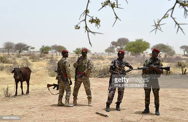 Chadian soldiers wait near the airport of Diffa southeastern Niger on April 3 near the Nigerian town of Malam Fatori which was retaken from Boko...