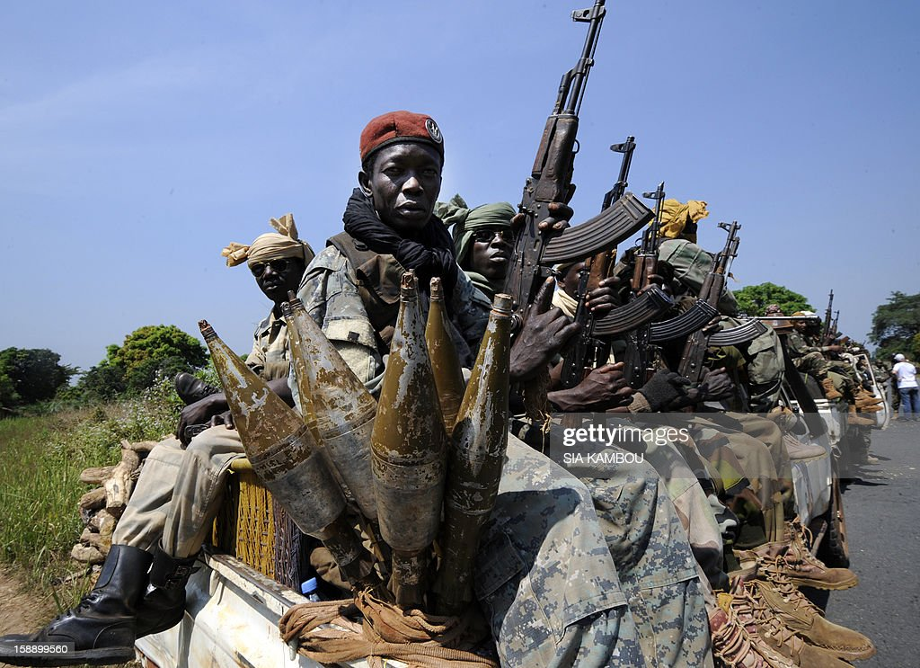 Chadian soldiers wait on a truck near the Damara, the last strategic town between the rebels from the SELEKA coalition and the country's capital Bangui, on January 2, 2013, as the regional African force FOMAC's commander warned rebels against trying to take the town, saying it would 'amount to a declaration of war.' The rebels, who began their campaign a month ago and have taken several key towns and cities, have accused Central African Republic leader Francois Bozize of failing to honor a 2007 peace deal.