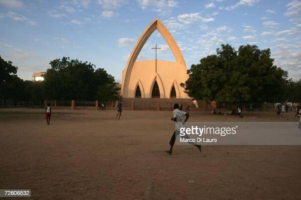 N'DJAMENA CHAD NOVEMBER 3 Chadian teenagers play football in front of the main Catholic Cathedral on November 3 2006 in N'Djamena Chad Chad declared...