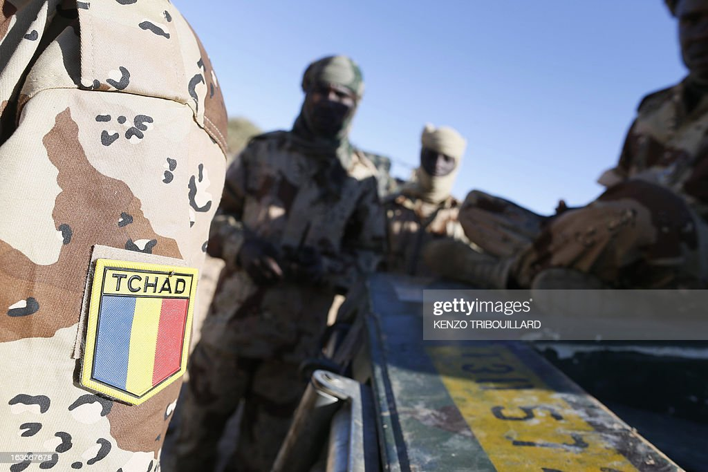 Chadian troops prepare their vehicles on March 14, 2013 before patrolling in the desert near Tessalit, Mali. French and Chadian troops engaged in AFISMA, the African mission of more than 6,000 soldiers, continue to battle Islamists entrenched in the northeastern Ifoghas mountains and in the desert around Gao.